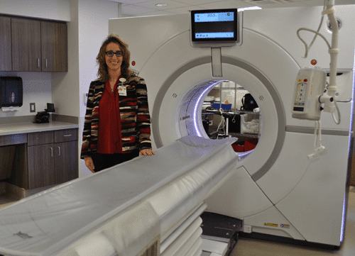 Lady next to an MRI